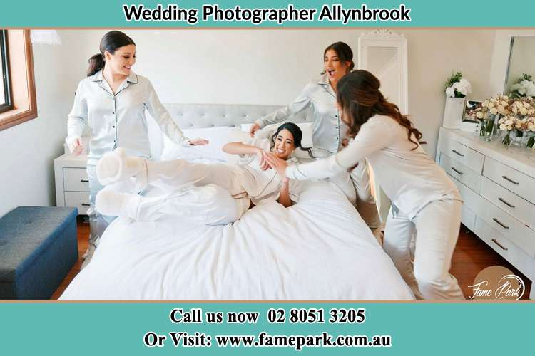 Photo of the Brides and the bridesmaids playing on bed Allynbrook NSW 2311