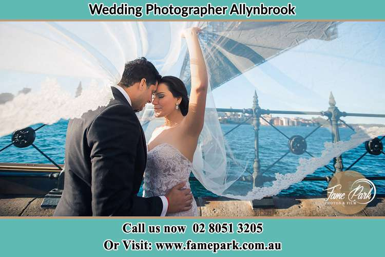 The Bride and the Groom near the shore Allynbrook