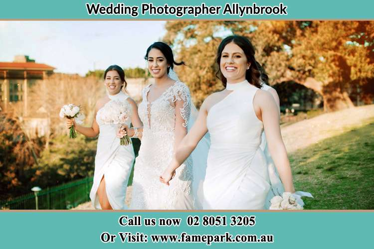 Photo of the Bride walking with her secondary sponsors Allynbrook NSW 2311