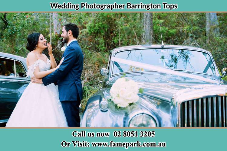 Photo of the Bride and the Groom beside the bridal car Barrington Tops NSW 2422