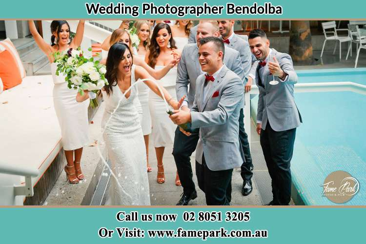 Bride and Groom party at the poolside Bendolba