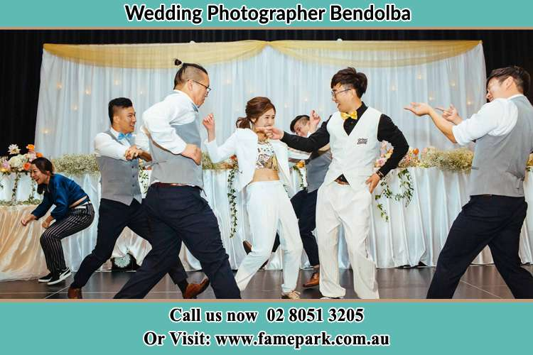 Photo of the Bride and the Groom dancing with the groomsmen Bendolba NSW 2420
