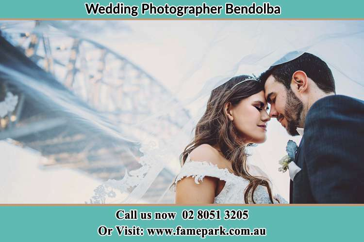 Close up photo of the Bride and the Groom under the bridge Bendolba NSW 2420