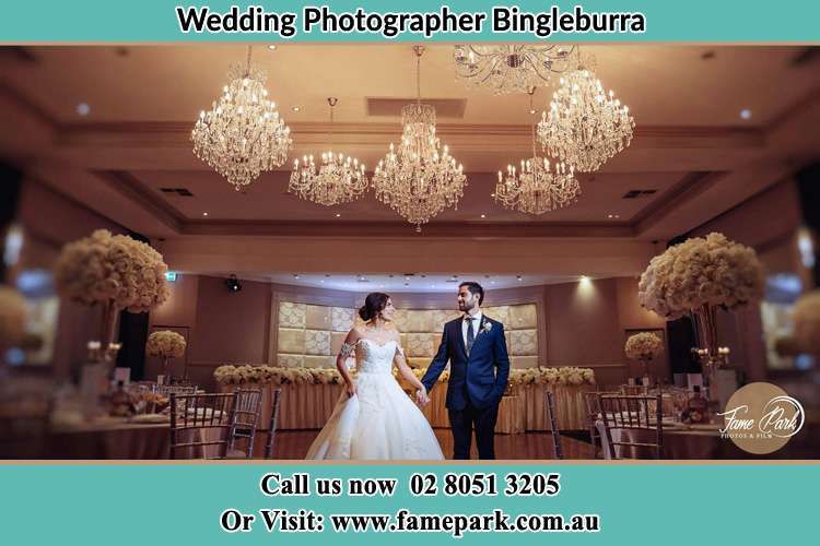 Photo of the Groom and the Bride holding hands on the dance floor Bingleburra NSW 2411