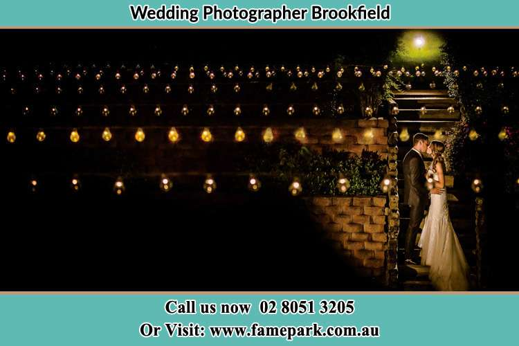 The Bride and Groom in the garden at night Brookfield