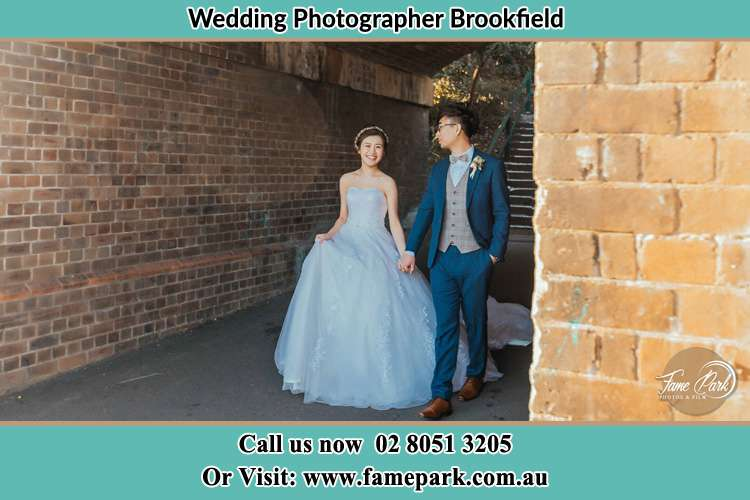 Photo of the Bride and the Groom holding hands while walking Brookfield NSW 2420