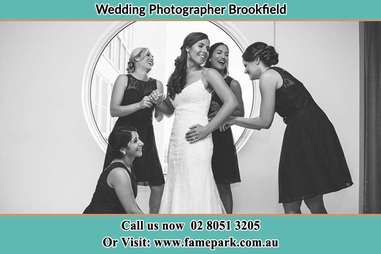 Photo of the Bride and her bridesmaids near the window Brookfield NSW 2420
