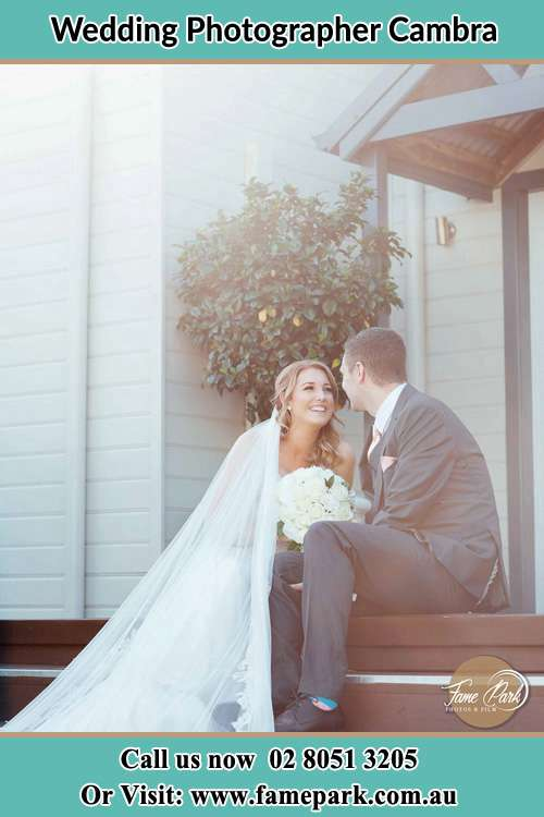 Bride and Groom sitting on a staircase Cambra
