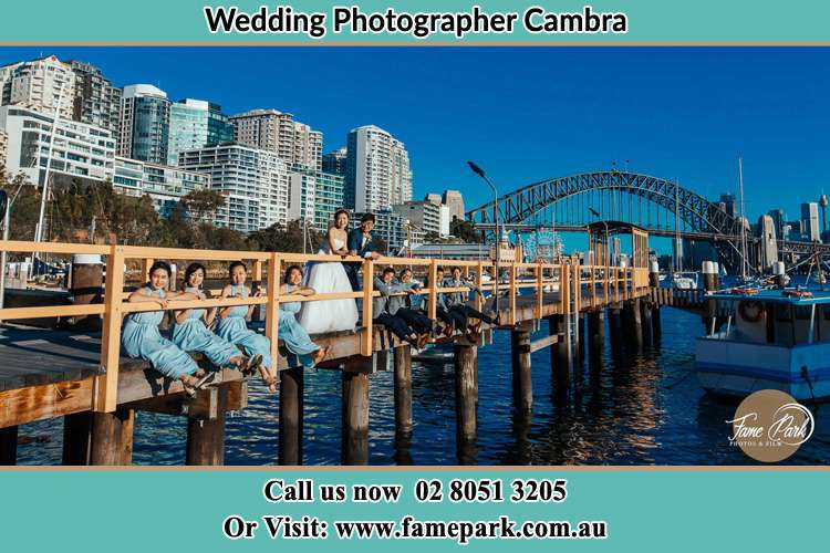Photo of the Bride and the Groom with the entourage at the bridge Cambra NSW 2420