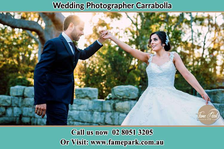 Bride and Groom dancing outside Carrabolla