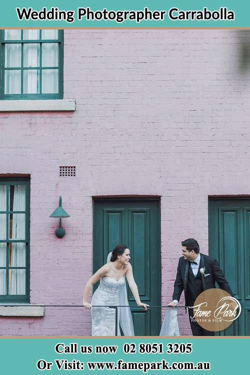 Photo of the Bride and the Groom looking each other at the balcony Carrabolla NSW 2311