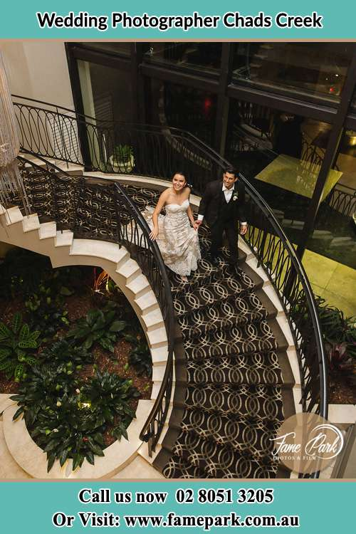 Photo of the Bride and the Groom going down the stair Chads Creek NSW 2311