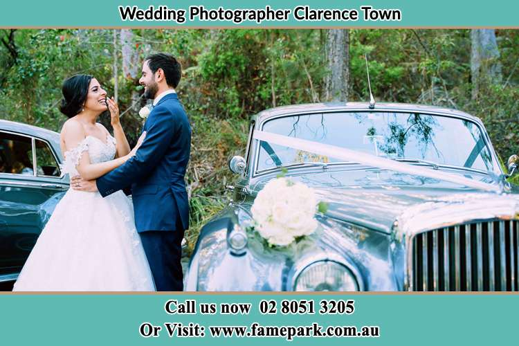 Bride and Groom beside the Bridal car Clarence Town