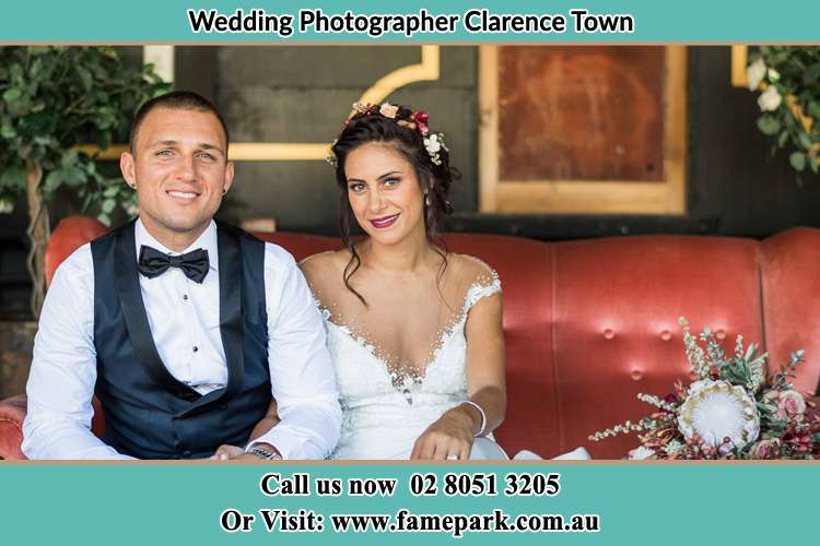 The Groom and the Bride sitting and smiling on camera Clarence Town NSW 2321
