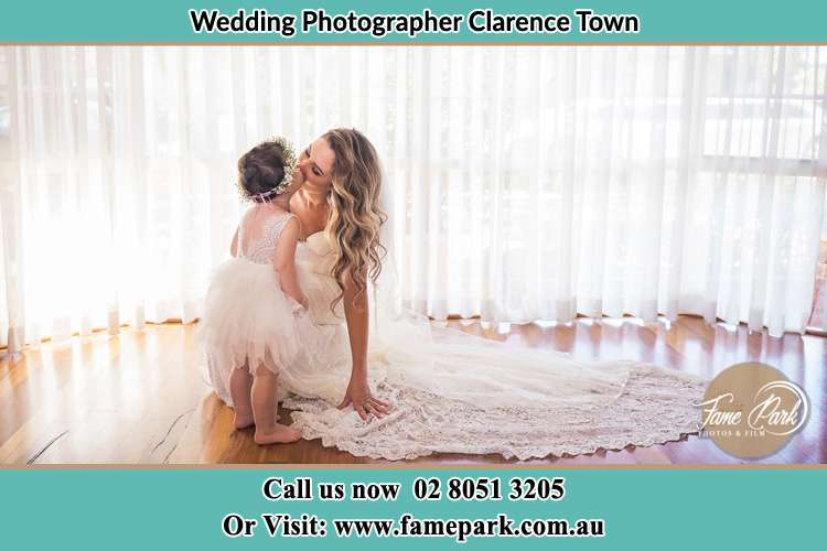 Photo of the Bride kissing the flower girl Clarence Town NSW 2321