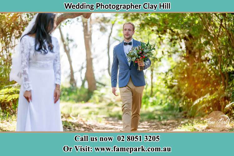 Photo of the Groom holding flower waiting by the Bride Clay Hill NSW 2420