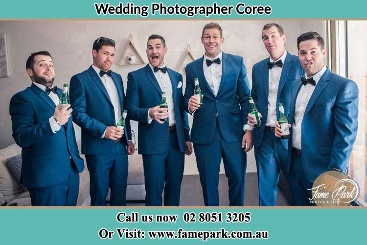 The groom and his groomsmen striking a wacky pose in front of the camera Coree NSW 2710
