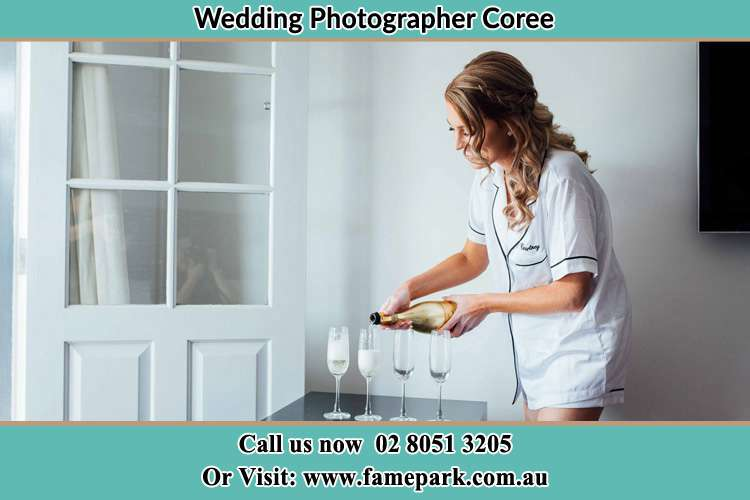 Photo of the Bride pouring wine to the glass Coree NSW 2710