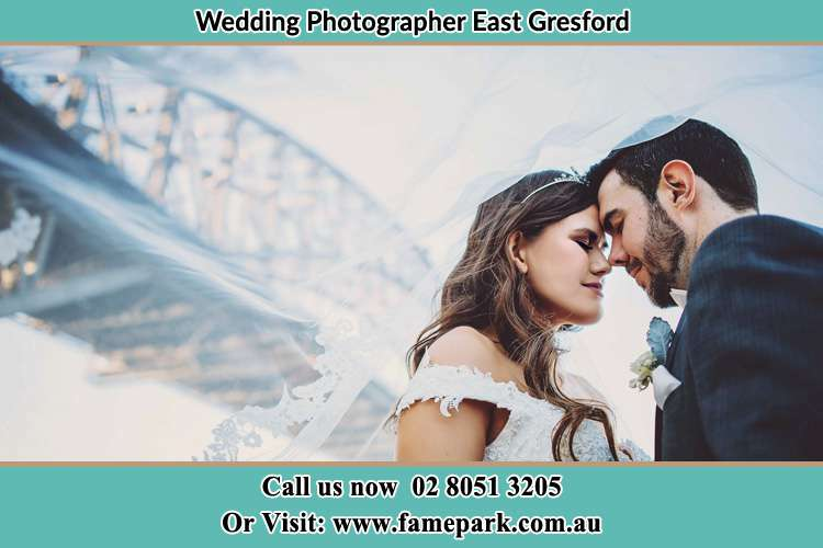 Bride and Groom under the bridge East Gresford