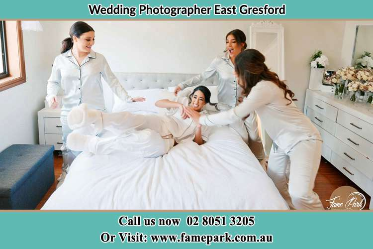 Photo of the Bride and her bridesmaids playing on bed East Gresford NSW 2311