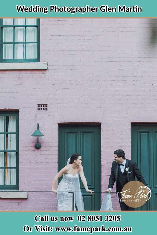 Photo of the Bride and the Groom looking each other at the balcony Glen Martin NSW 2321