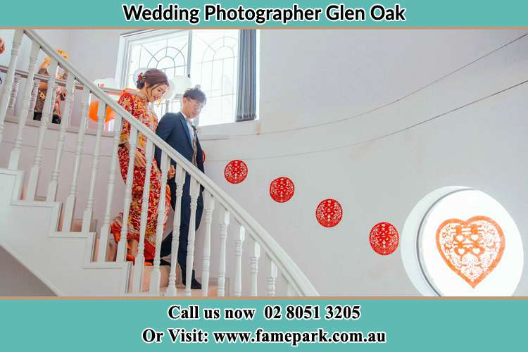 Photo of the Bride and the Groom going down the stair Glen Oak NSW 2320