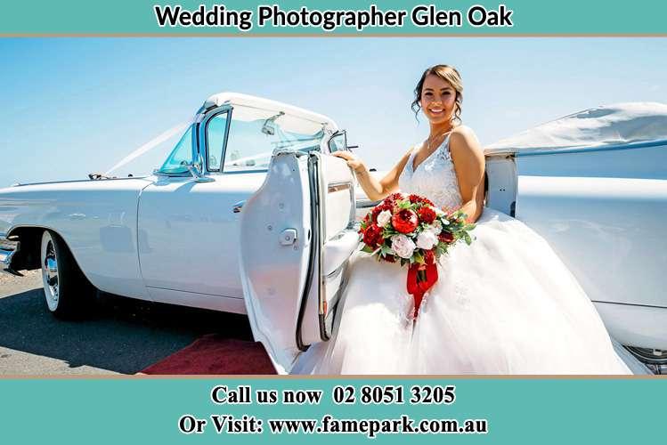 Bride sitting at the Bridal car Glen Oak