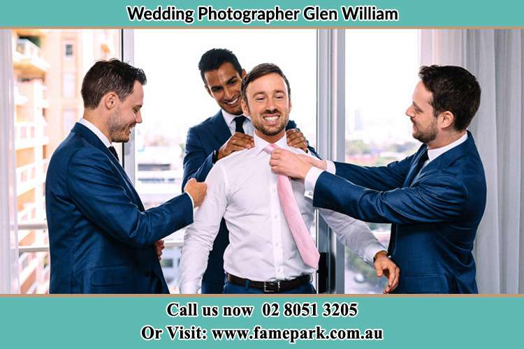 Photo of the Groom helping by the groomsmen getting ready for the wedding Glen William NSW 2321