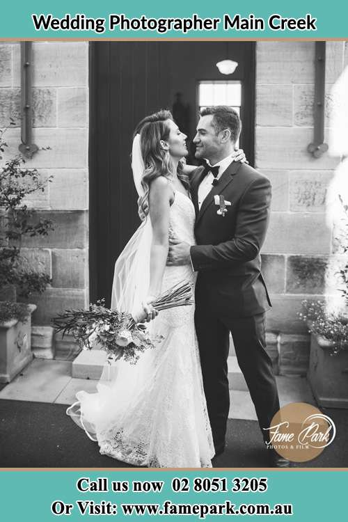 Photo of the Bride and the Groom happily looking each other Main Creek NSW 2420