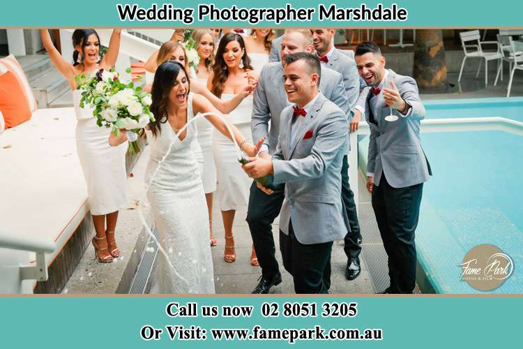Photo of the Groom and the Bride celebrating champagne with their entourage Marshdale NSW 2420