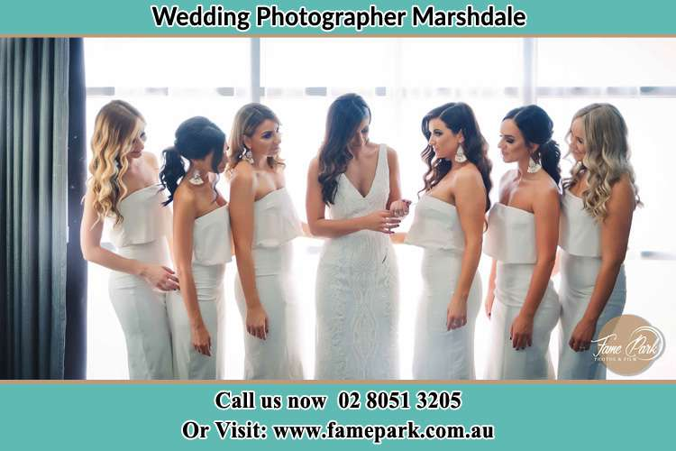 Photo of the Bride and her bridesmaids looking at her Marshdale NSW 2420