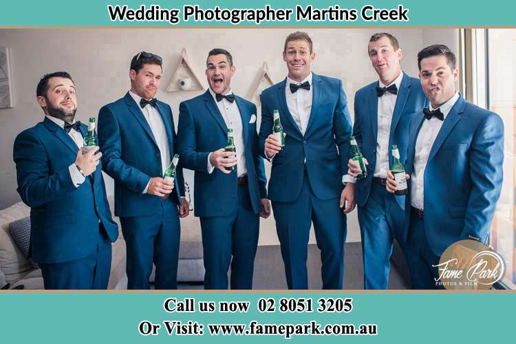 The groom and his groomsmen striking a wacky pose in front of the camera Martins Creek NSW 2420