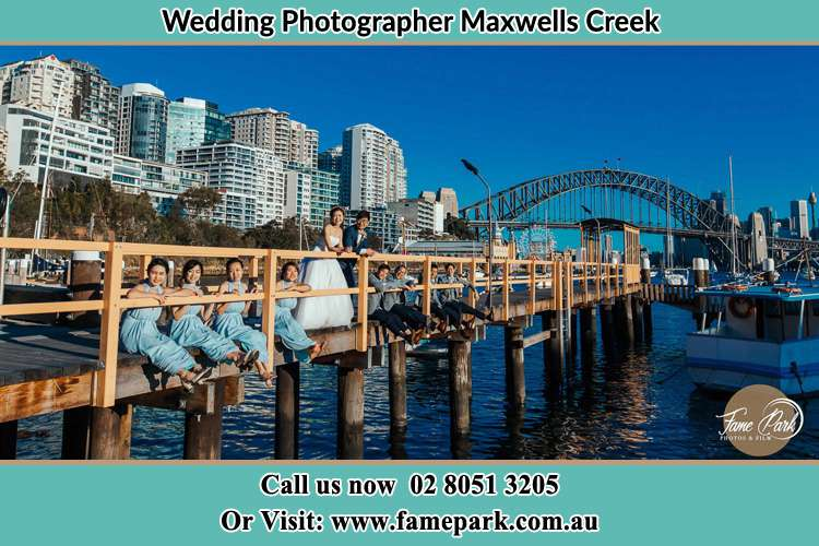 Photo of the Groom and the Bride with the entourage at the bridge Maxwells Creek NSW 2420