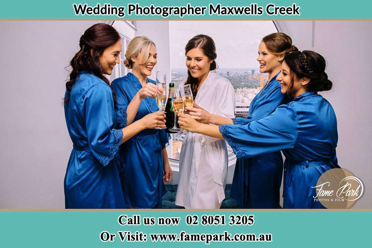 Photo of the Bride and the bridesmaids having wine Maxwells Creek NSW 2420