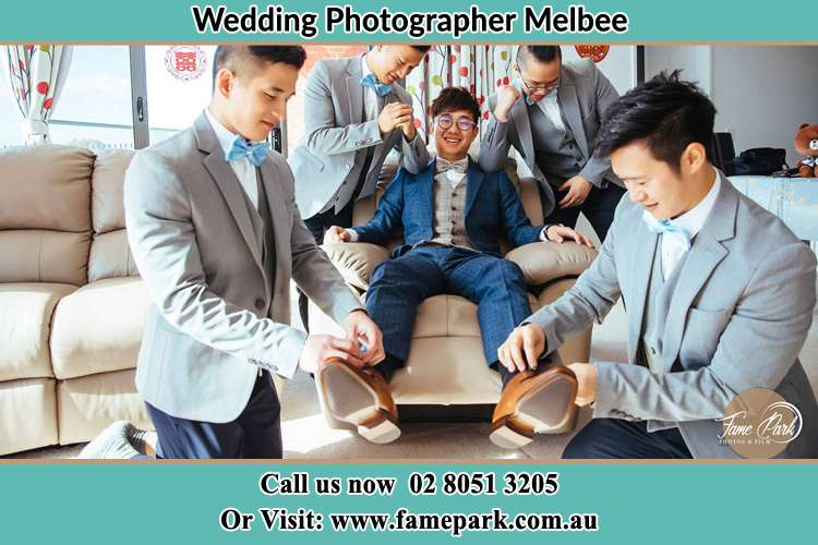 Photo of the Groom helping by the groomsmen getting ready for the wedding Melbee NSW 2420