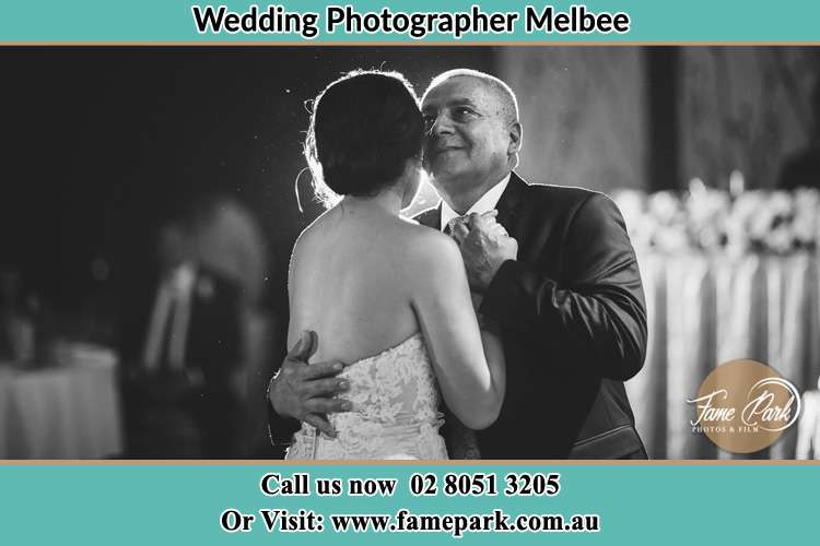The Bride and her Father dance at the dance floor Melbee