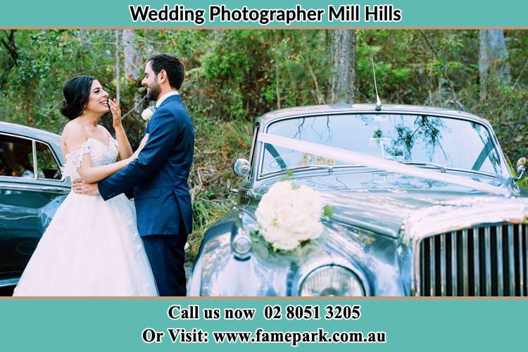 Photo of the Bride and the Groom besides the bridal car Mill Hills NSW 2022