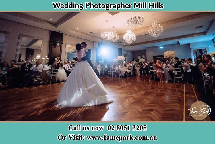 Photo of the Groom and the Bride hugging at the dance floor Mill Hills NSW 2022