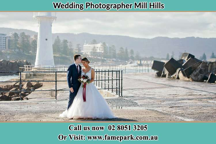 Bride and Groom Near the watch tower Mill Hills