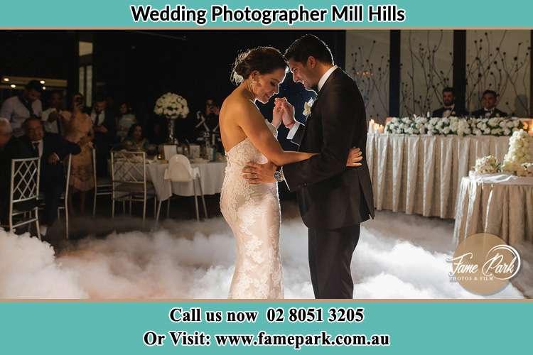 Bride and Groom dance in the dance floor Mill Hills
