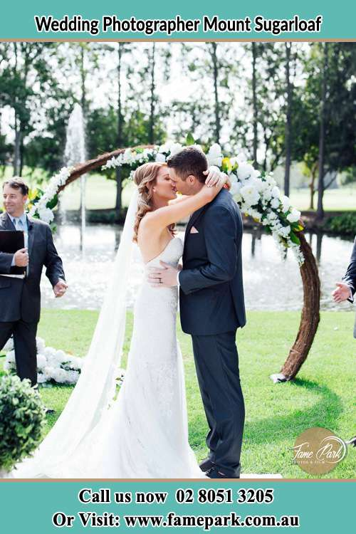 Photo of the Bride and the Groom kissing ceremony at the wedding garden Mount Sugarloaf NSW 2286