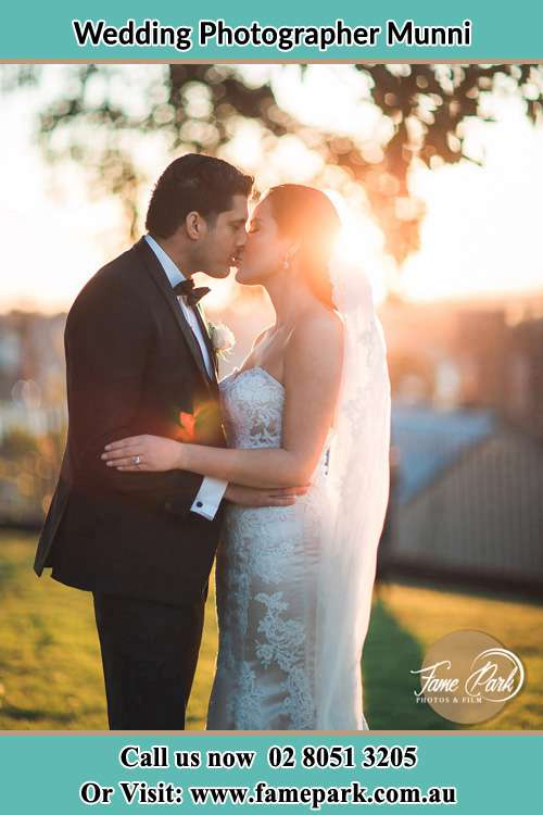 Bride and Groom kiss during sunset Munni