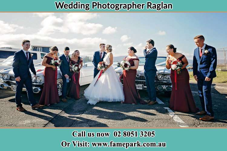 Photo of the Groom and the Bride with their entourage at the park Raglan NSW 2795