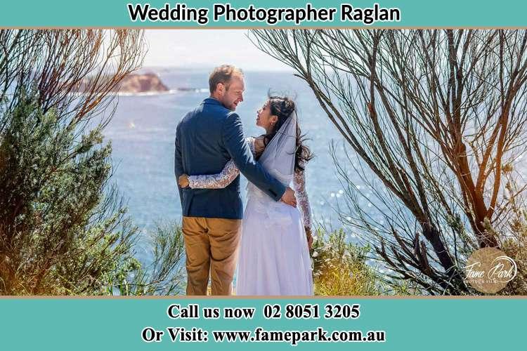 Bride and Groom near the shore Raglan