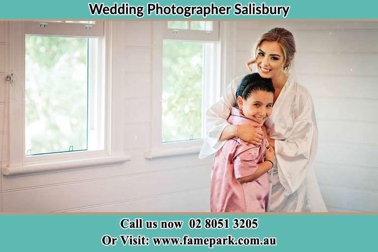 Photo of the Bride hugging her flower girl Salisbury NSW 2420