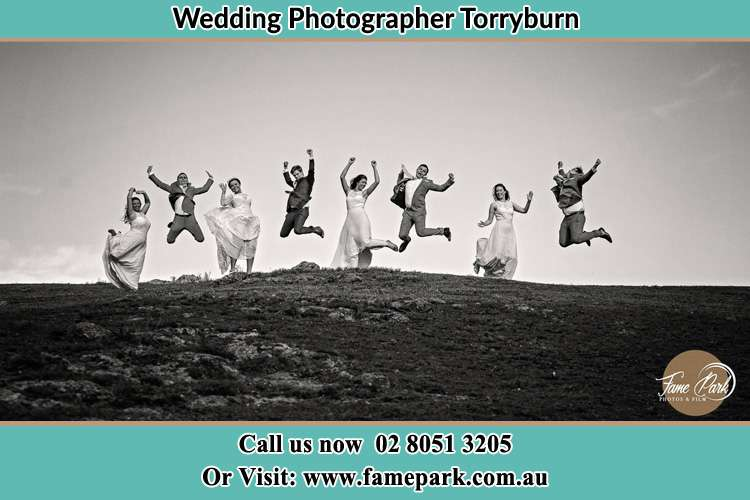 Photo of the Groom and the Bride with the entourage having a jump shot Torryburn NSW 2358