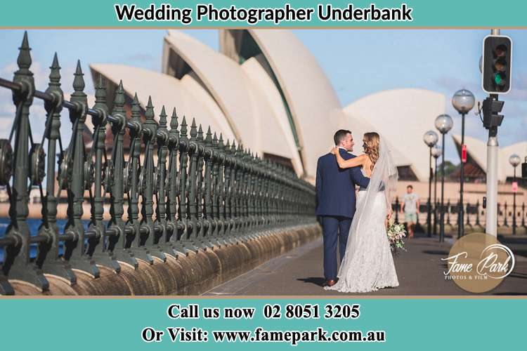 The Groom and the Bride walking towards the Sydney Grand Opera House Underbank NSW 2420