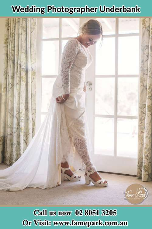 Photo of the Bride checking her shoes Underbank NSW 2420
