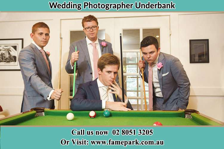 Photo of the Groom and the groomsmen playing billiard Underbank NSW 2420