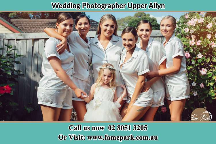 The Brides and the bridesmaids with the flower girl posing on camera Upper Allyn NSW 2311